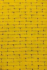 Yellow background. A yellow wall. The yellow brick. Large brick wall