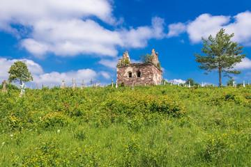 Old burial chapel on abandoned cemetery near Chervonohorod Castle ruins in Ukraine