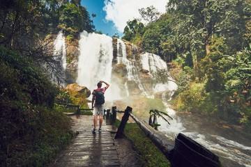 Traveler near waterfall