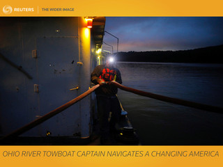 The Wider Image: Ohio River towboat captain navigates a changing America