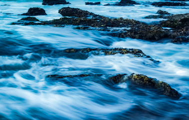 long exposure of rock pools by the beach