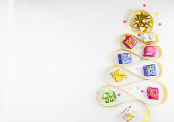 Golden ribbons Gift boxes New year accessories.Christmas concept copy space,Top view,flat lay