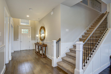 Fabulous foyer features a staircase