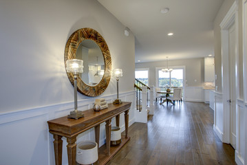 Fabulous foyer features a wood console table