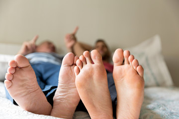 Feet of Friends/Father and Son playing on the bed