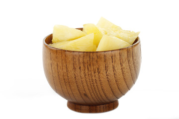 slices of pineapple in wooden cup isolated