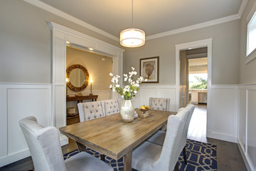 Elegant transitional dining room with board and batten walls