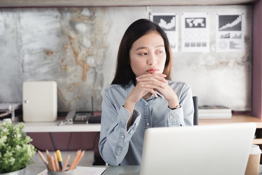Asian women Stressful Working with a notebook for a long time , Office syndrome concept