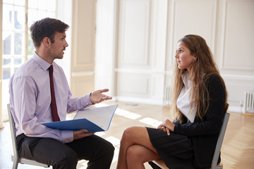 Female Teenage Student Having Discussion With Tutor