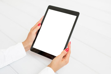 Woman holding digital tablet in vertical position. Screen mockup.