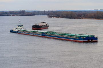 Cargo ship and barge sailing on the river Dnieper
