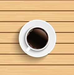 Coffee cup on wooden table top view.