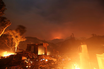 A home burns as strong winds push the Thomas Fire across thousands of acres near Santa Paula