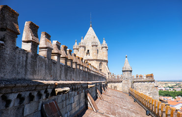 Roof slope with lantern tower and battlements. Evora cathedral. Evora. Portugal