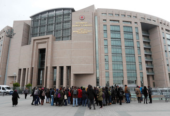 Academics and university students attend a demonstration in front of the Justice Palace in Istanbul
