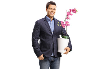 Young guy holding an orchid flower in a pot