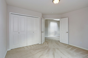 Empty room interior with carpet floor and white walls