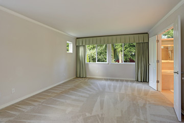 Empty room with carpet floor and grey walls
