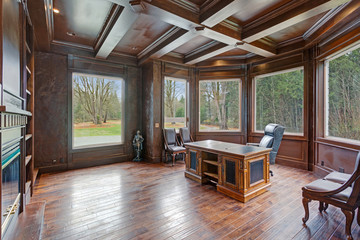 Chic Wood Paneled Home office features coffered ceiling