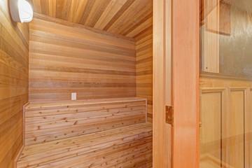 Mansion home sauna room with teak surround