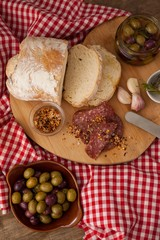 Bread and olives with meat on napkin
