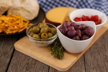 Olives and vegetable by french fries with bread