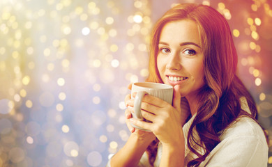Fototapete - happy woman with cup of tea or coffee at home