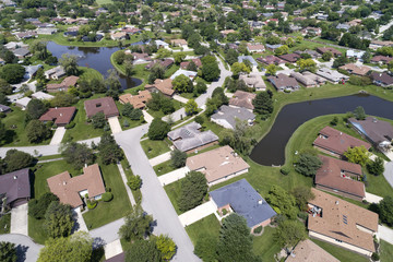 Neighborhood Aerial View With Ponds