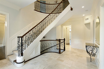 Foyer with wrought iron staircase railing