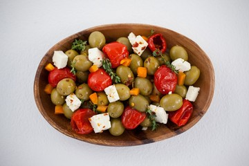 Olives with chili pepper and cheese served in bowl