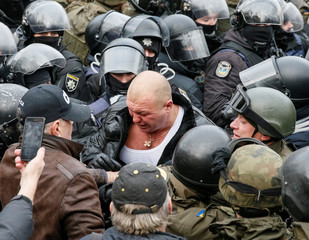 Supporter of former Georgian president Saakashvili clashes with riot police in Kiev