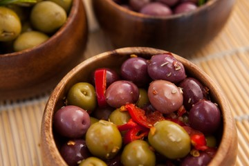 High angle view of olives in wooden container