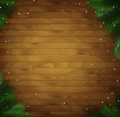 wooden holiday background with snow and Christmas tree branches,