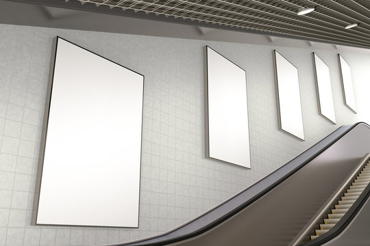 Blank advertising poster on underground escalator wall