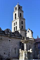 Lion fountain and church beyond Plaza San Fransisco de Asis, Havana, Cuba