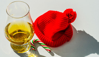 Single Malt Whiskey in a glass with a red cap, luxury tasting glass