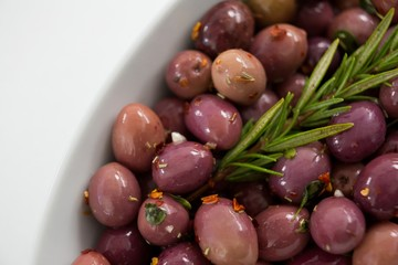 Olives garnished with rosemary