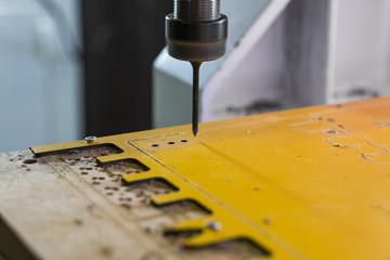 Work on the CNC machine.