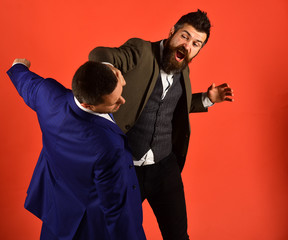 Businessman with raging face hits and punches opponent.