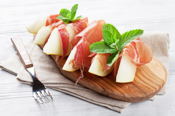 Fresh melon with prosciutto and mint