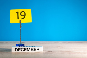 December 19th mockup. Day 19 of december month, calendar on blue background. Winter time. Empty space for text
