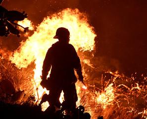 Firefighters battle a Santa Ana wind-driven brush fire called the Thomas Fire near Ventura
