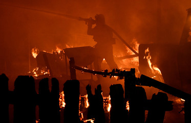 Firefighters battle flames from a Santa Ana wind-driven brush fire called the Thomas Fire in Santa Paula, California