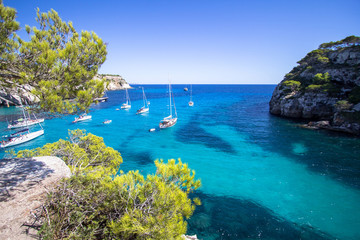 Boats and yachts on Macarella beach, Menorca, Spain