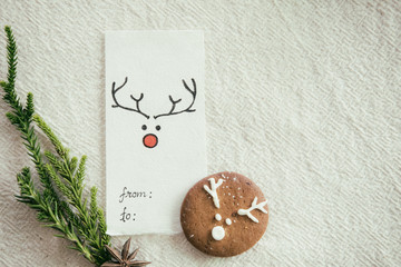 Christmas card and homemade gingerbread cookie.