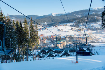 View from ski lift at winter ski resort in the mountains on a sunny morning nature calamity peace travel tourism concept