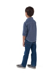 Boy standing against white background