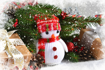 White New Year photo background with a snowman and decoration from boxes, balls. Happy New Year and Merry Christmas!