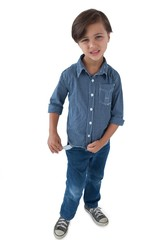 Boy standing with empty pockets against white background