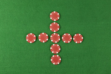 red poker chips above green cloth